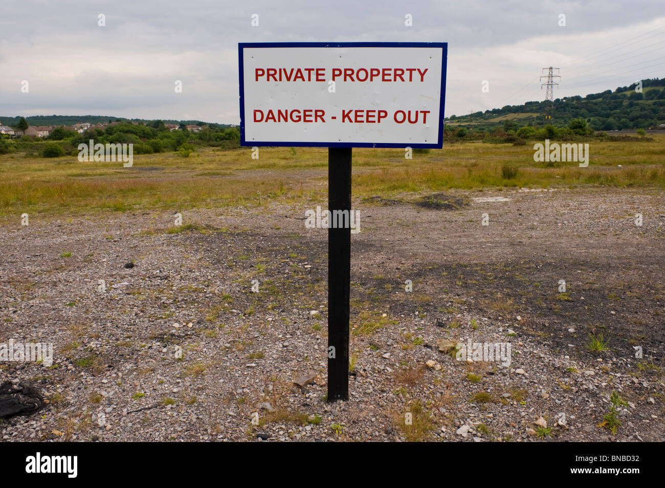 PRIVATE PROPERTY DANGER KEEP OUT sign on former coal mine workings at The British Torfaen South Wales UK - Stock Image
