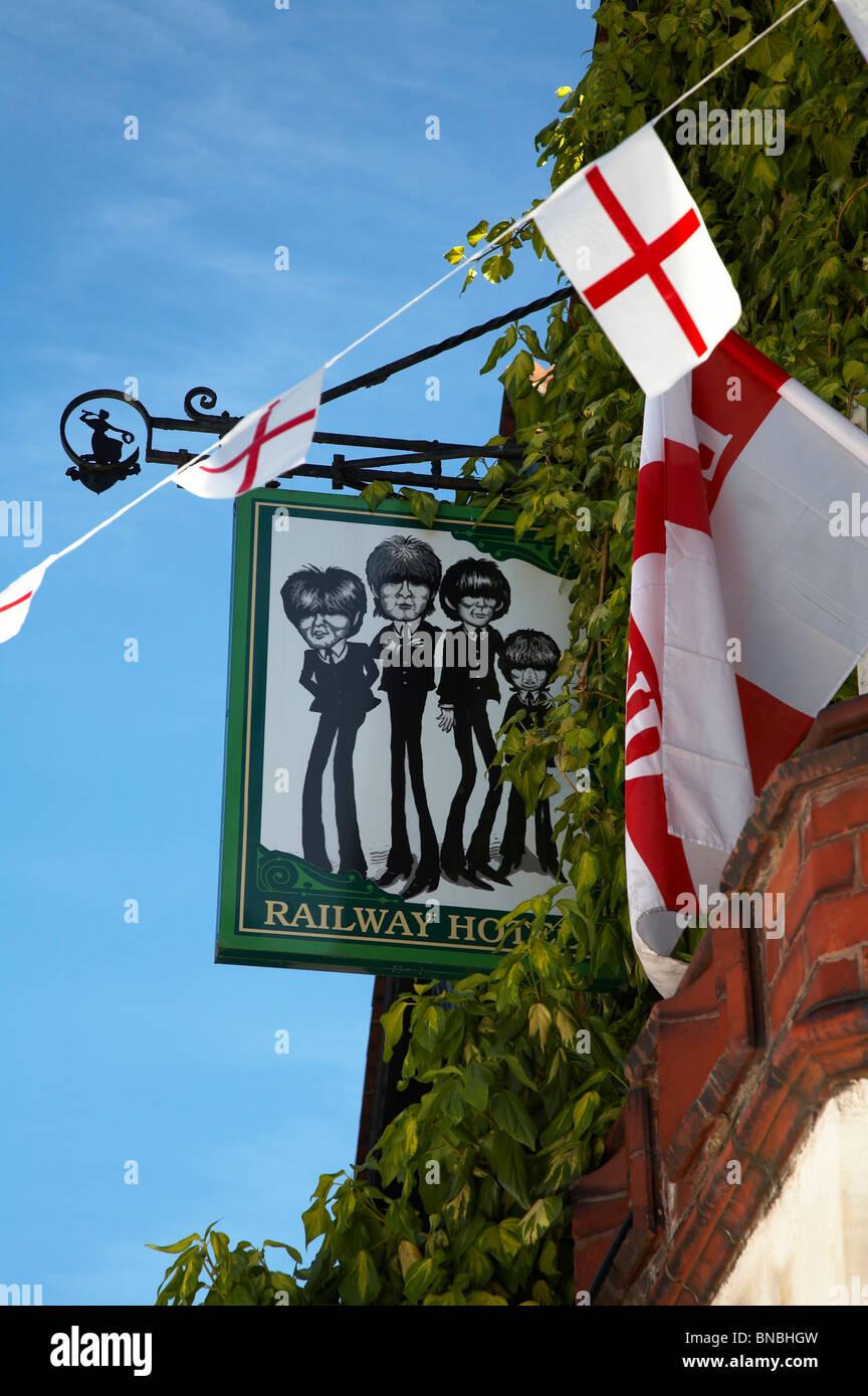 Beatles pub sign outside Railway hotel in Nantwich UK - Stock Image