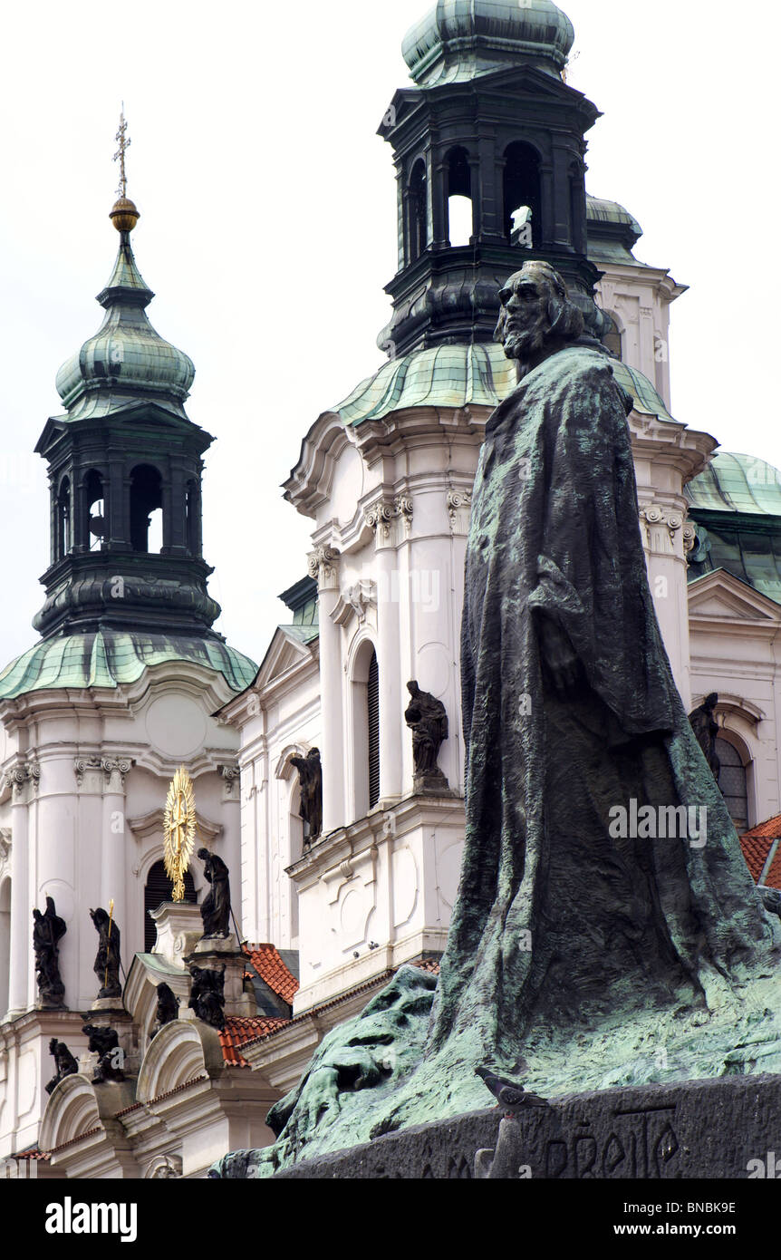 statue of reformer jan hus from prague and church of st. nicholas - Stock Image