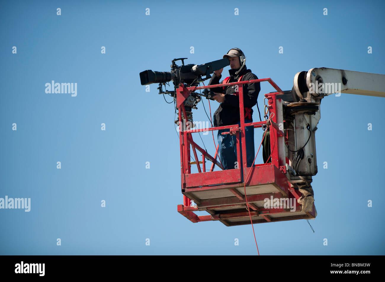 Broadcast TV cameraman on elevated platform, UK - Stock Image