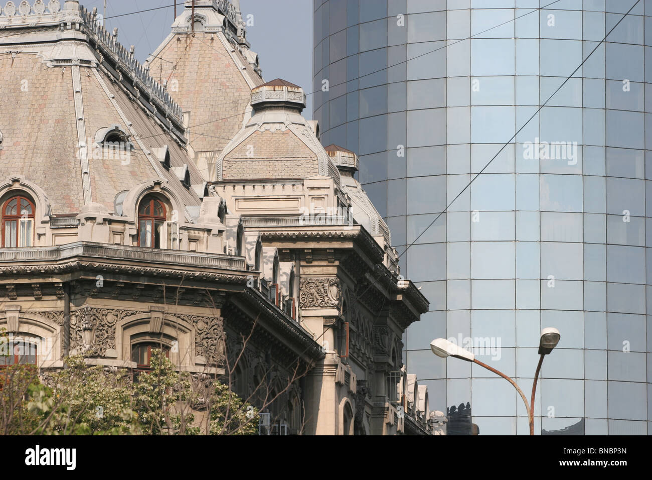 Old and new, contrasting styles of architecture in Bucharest, Romania. - Stock Image