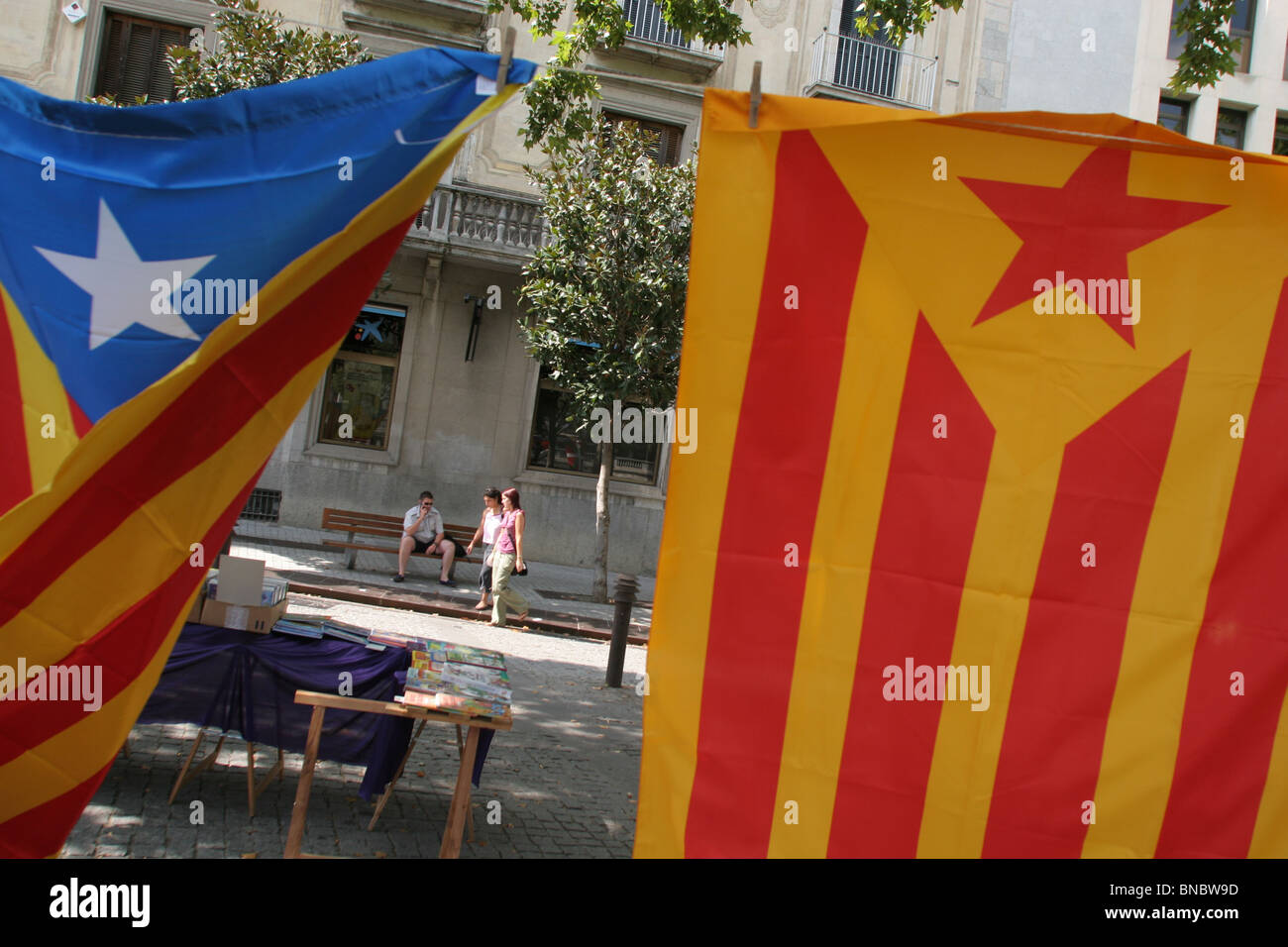 Stall selling flags and pin badges of Catalonian political parties/ separatist movement, Girona /Gerona, Catalonia, - Stock Image