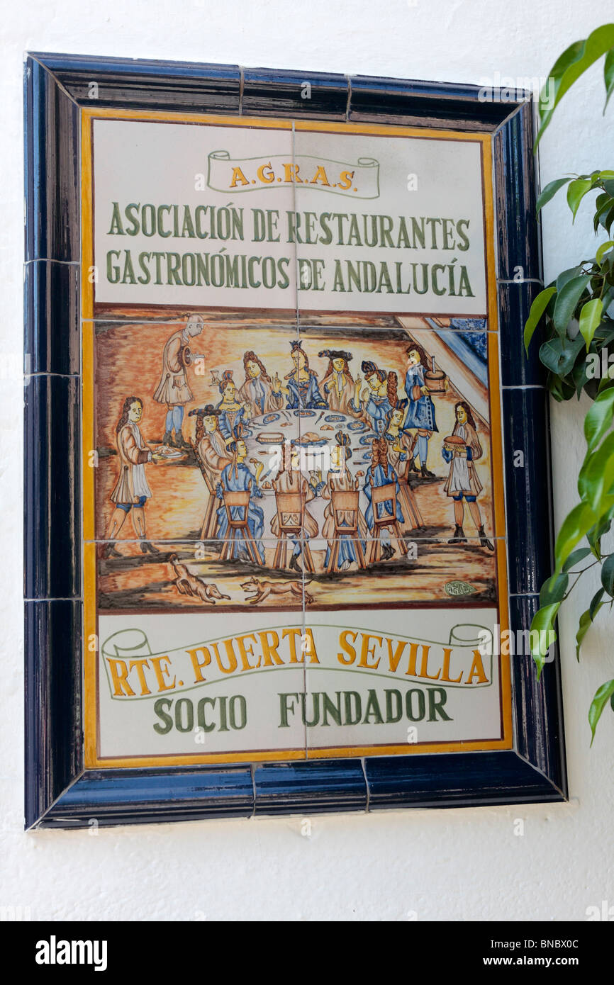 Tiled sign at the restaurant Puerta Sevilla in Cordoba declaring them a founding member of the Assocation of Gastronomic - Stock Image