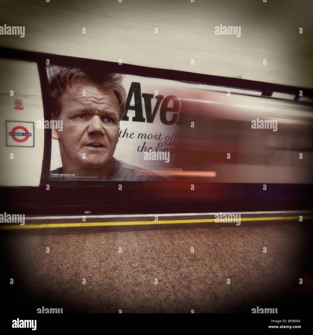 London Underground Train passing through station, London, Britain. - Stock Image