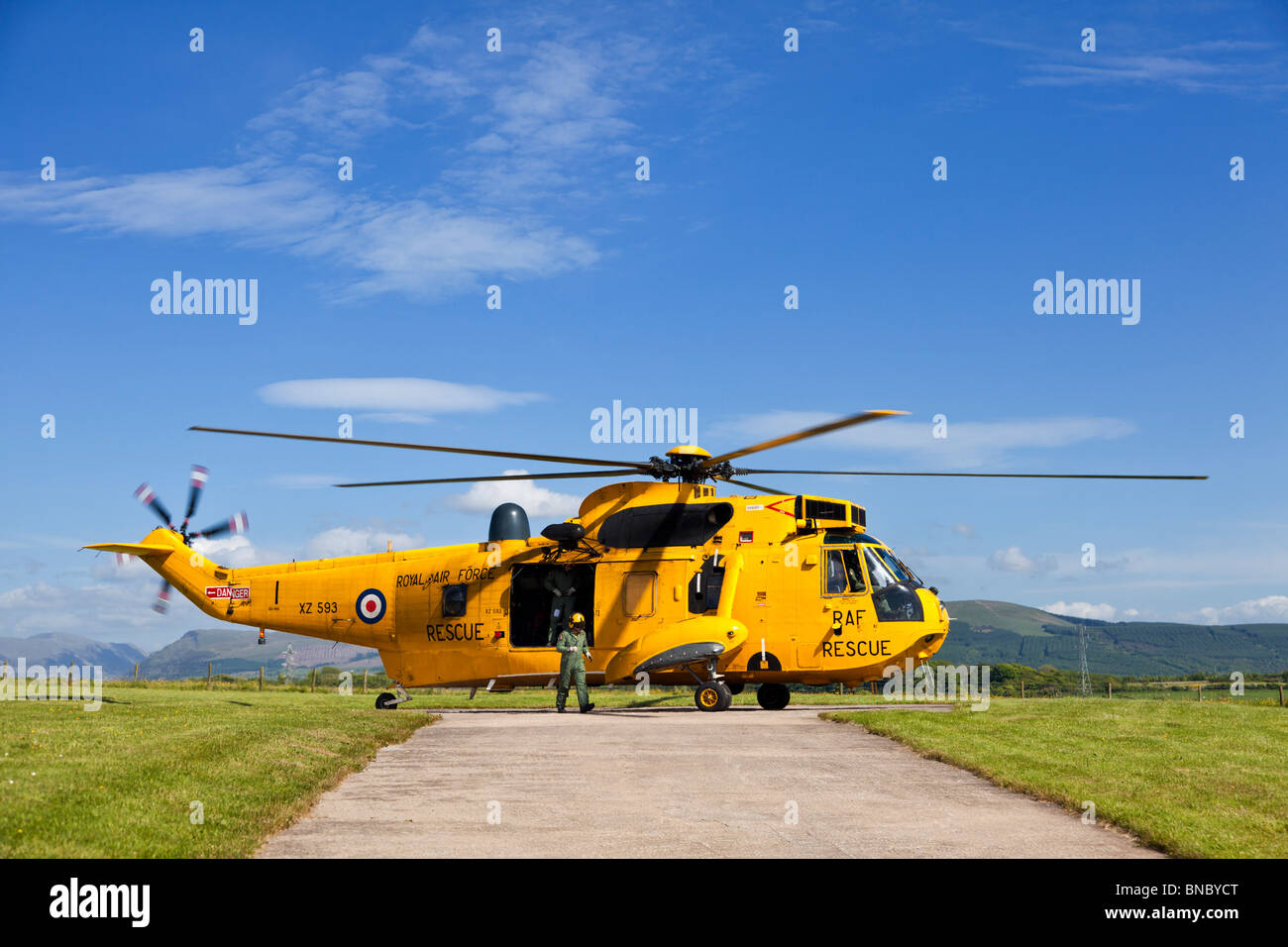 RAF Search and Rescue Sea King helicopter and crew in pre flight preparations The Lake District England UK - Stock Image