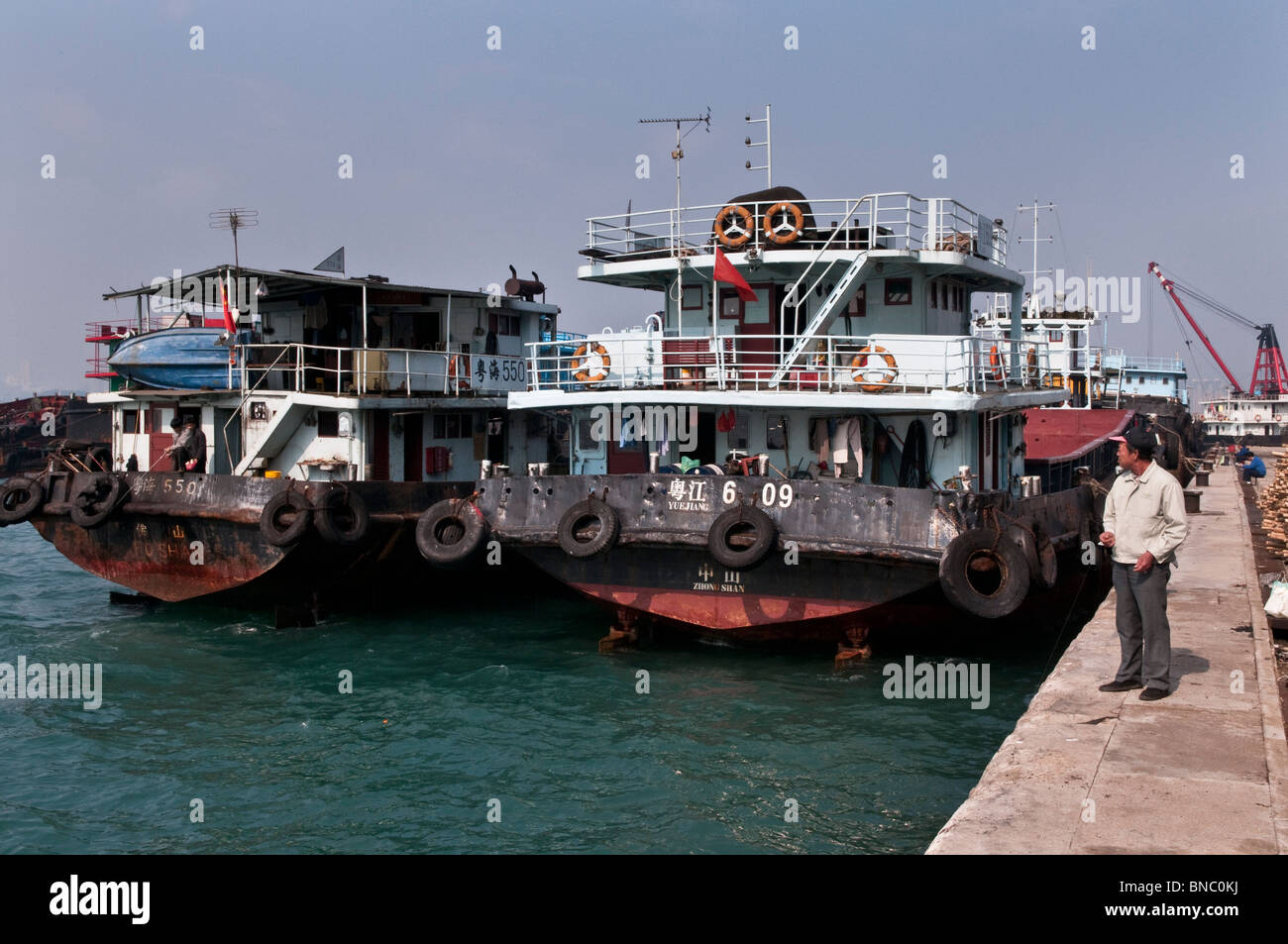 Hong Kong,At the harbour and pier at the Western District on Hong Kong Island, Kennedy Town - Stock Image