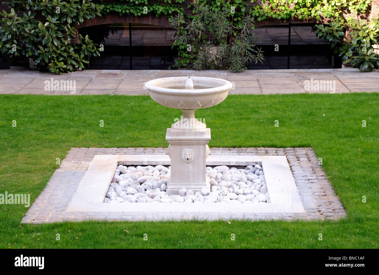 Ornamental fountain in The Worshipful Company of Goldsmiths garden off Gresham Street in the City of London, England, - Stock Image