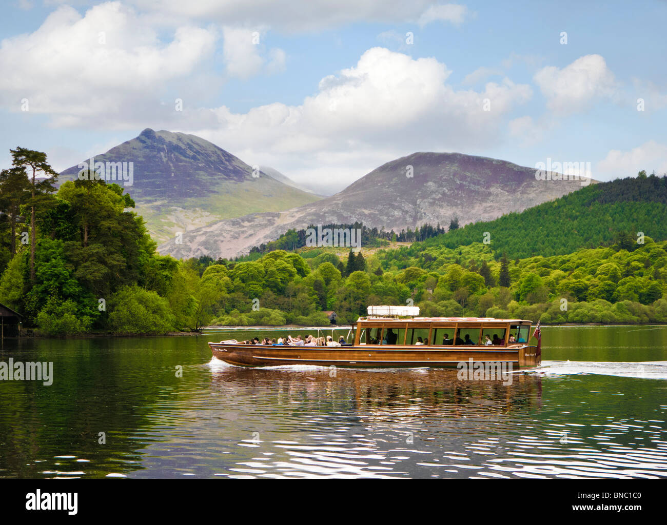 Keswick Launch on Derwentwater lake with Cat Bells, Causey Pike and Barrow mountains, The Lake District, UK - Stock Image