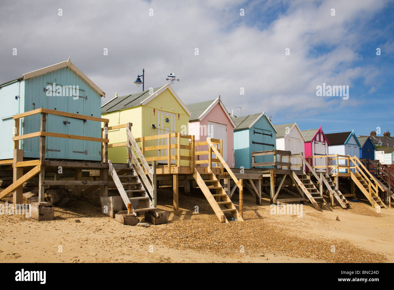 Pretty, traditional beach huts on Felixstowe beach in Suffolk, England. - Stock Image
