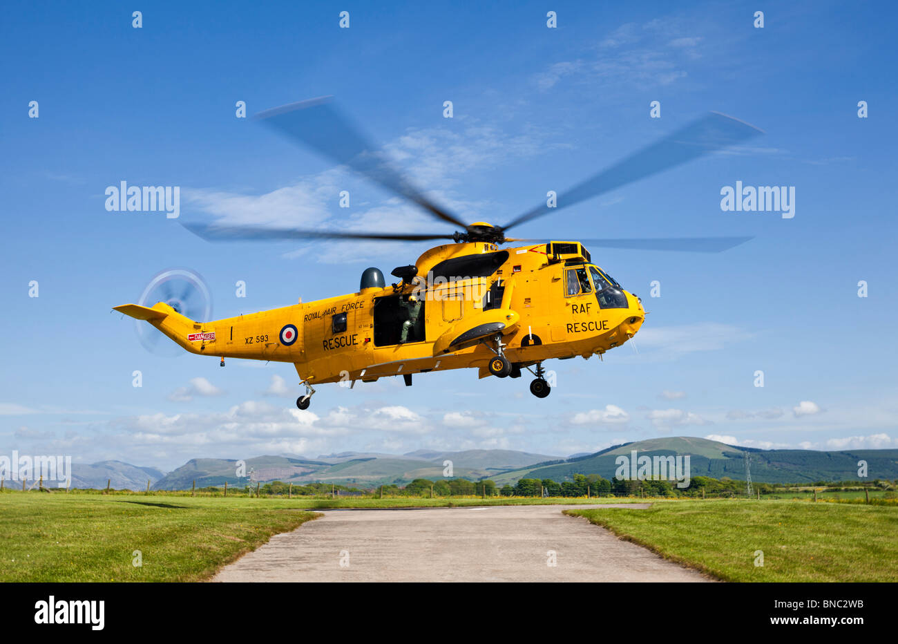 RAF Search and Rescue Sea King helicopter in flight, Cumbria, England, UK - Stock Image