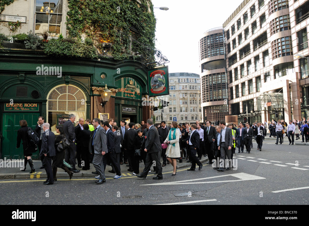 People evacuated from a building near Liverpool Street Station London England UK Stock Photo