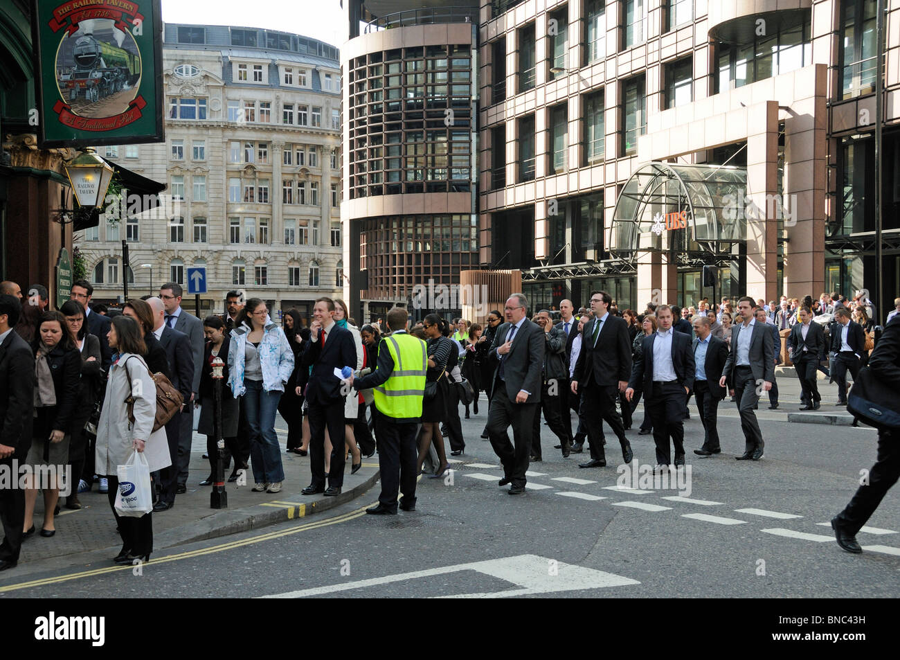 Crowd of people evacuated from a building near Liverpool Street Station London England UK Stock Photo