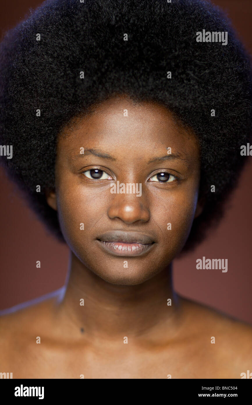 Portrait of young woman of African descent with retro afro hairstyle - Stock Image