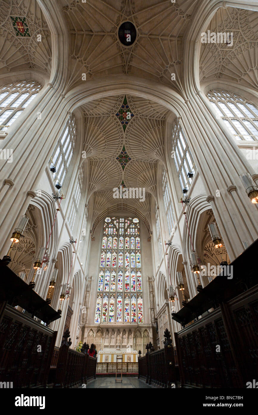 Soaring Ceiling and Stained Glass window above the choir and altar. The fine fan vaulting above. - Stock Image