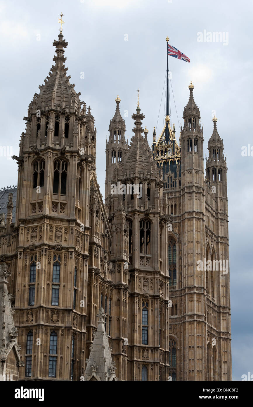 Union Jack Flying  high over Westminster. A union jack flag flies over the palace of westminster - Stock Image