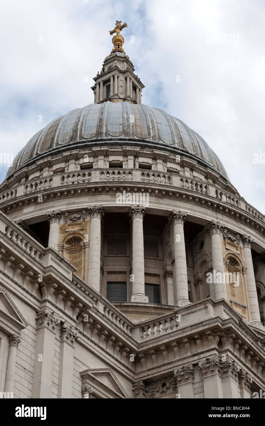 The dome of St Paul's London from below. The dome and topping guilded cross of St Paul's Cathedral  shot - Stock Image