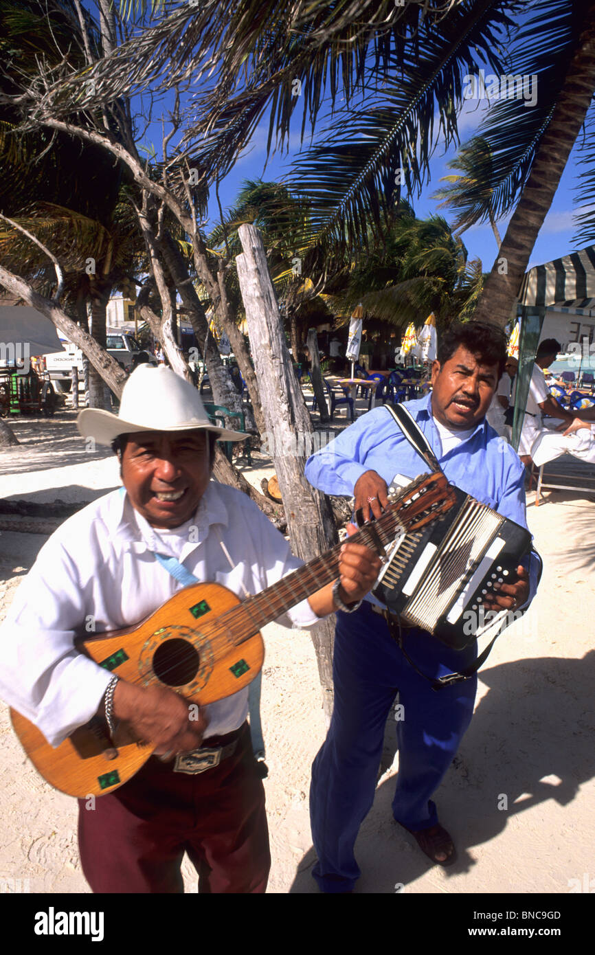 Colorful Mariachi band playing on the beach in Costa Maya Mexico  - Stock Image