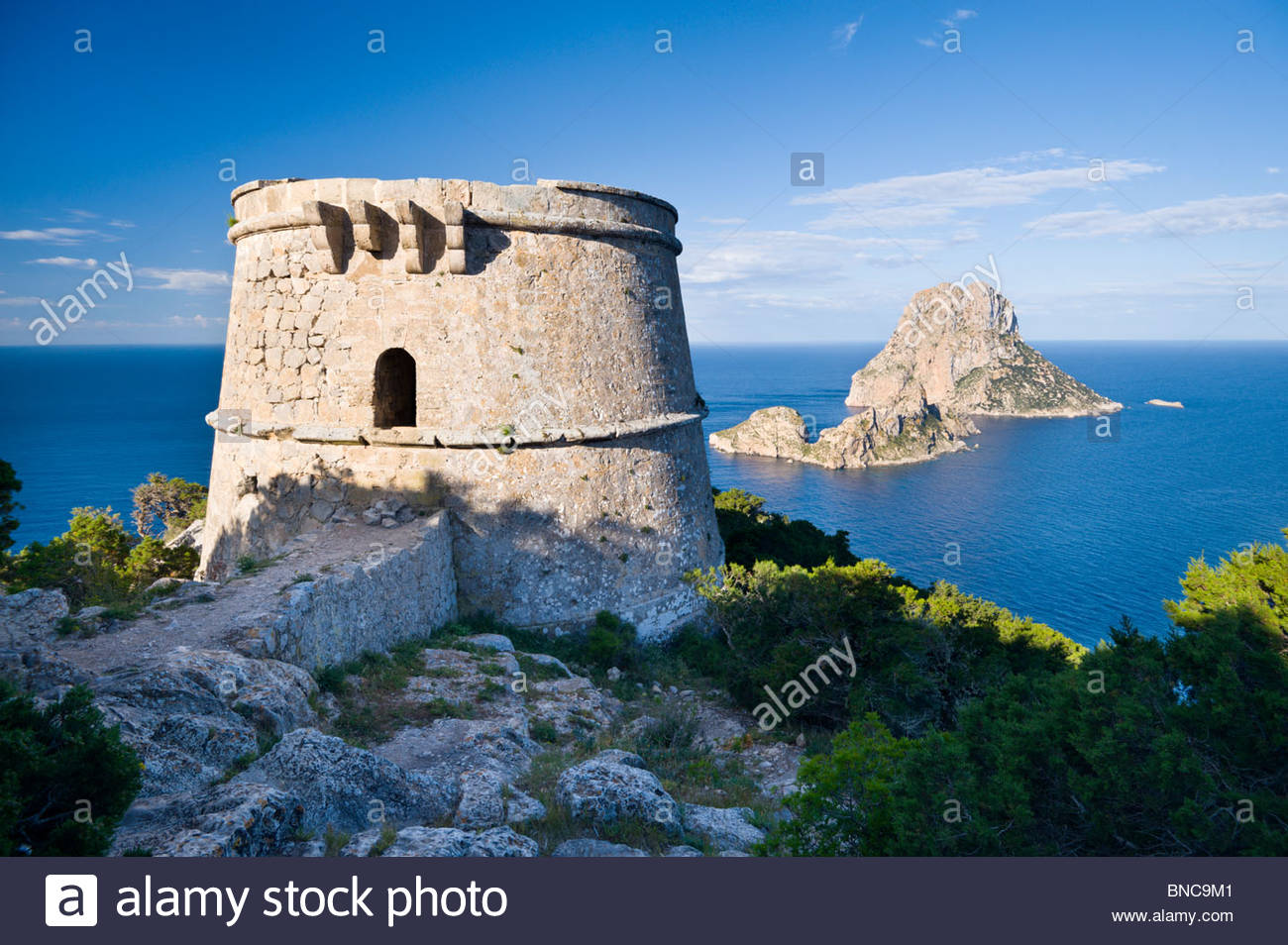Es Vedra and Es Vedranell islands from Torre des Savinar, Ibiza, Spain. - Stock Image