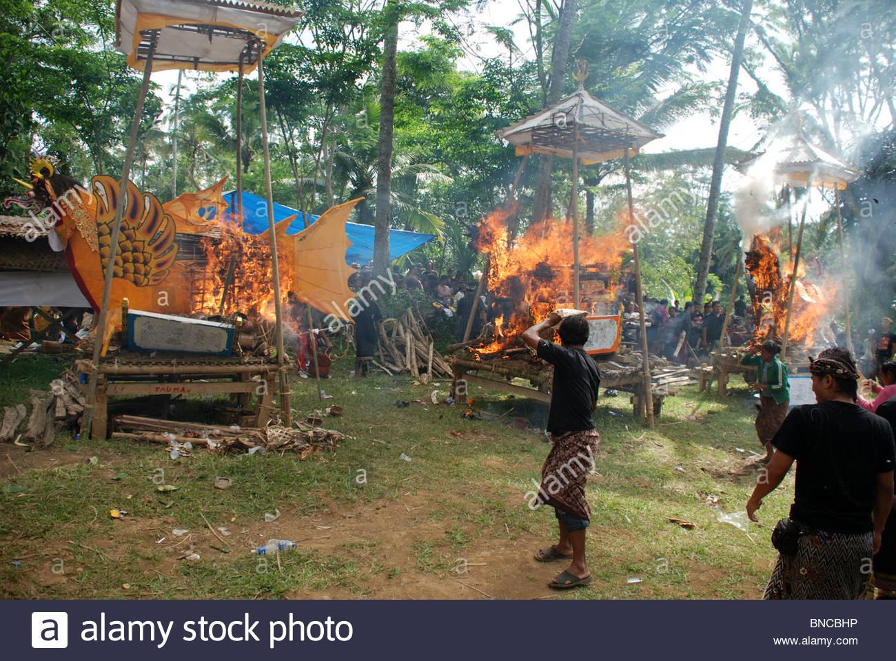 Three ornate coffins burn in mass Hindu cremation ceremony Bangli Bali Indonesia - Stock Image