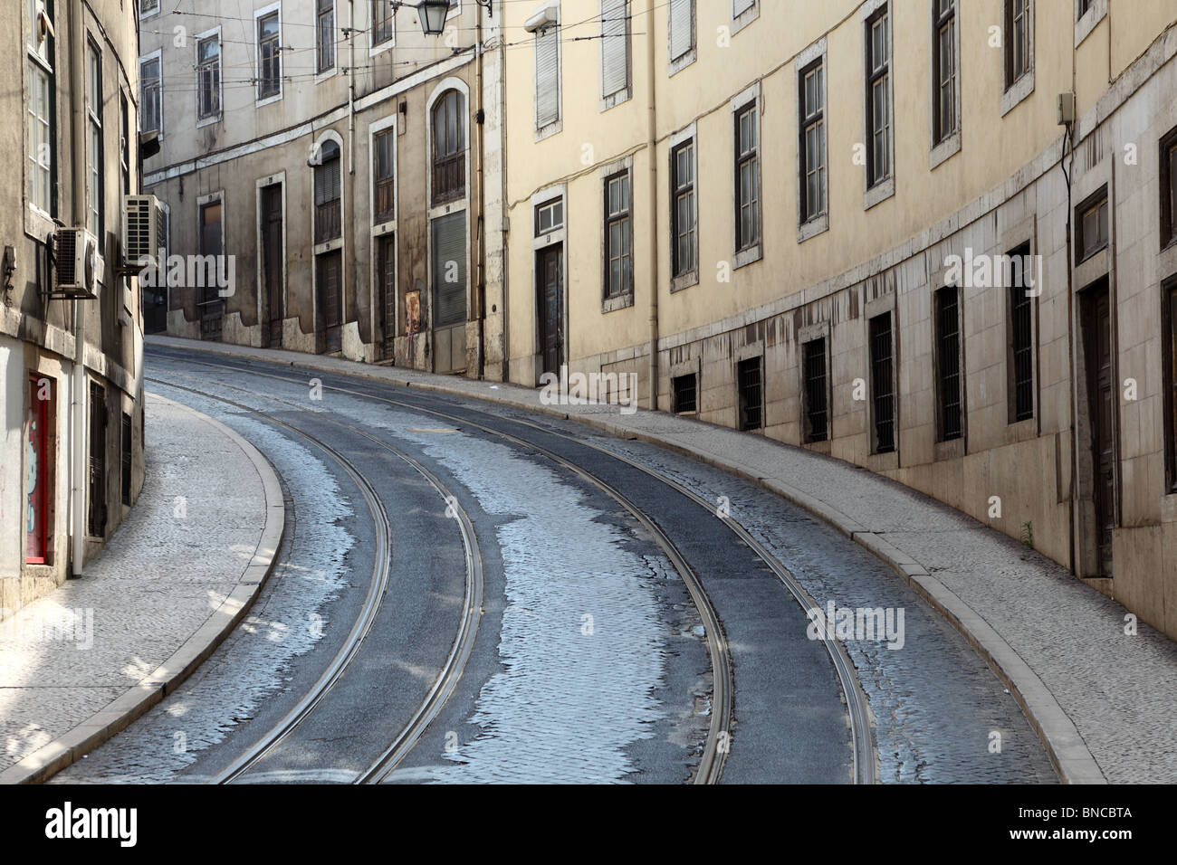 Street with tramway rails in Lisbon, Portugal - Stock Image