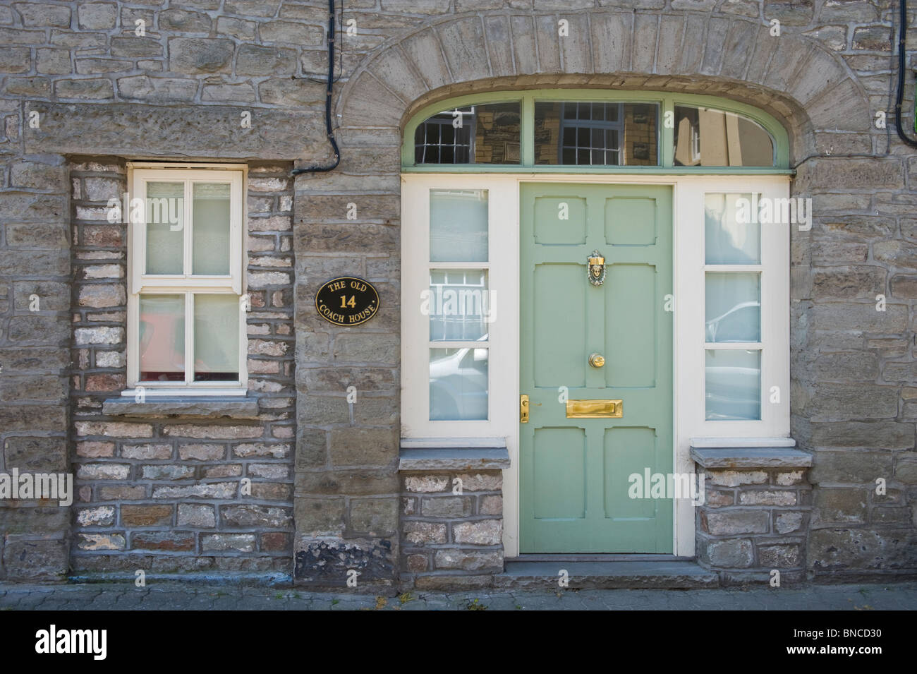 No 14 former coach house with green front door in Hay-on-Wye Powys Wales UK Stock Photo
