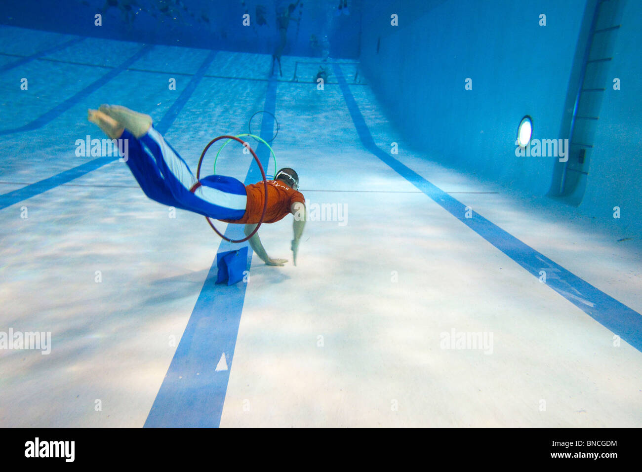 Training of the 'SNSM' lifeguards in a swimming pool : exercise with hoops - Stock Image