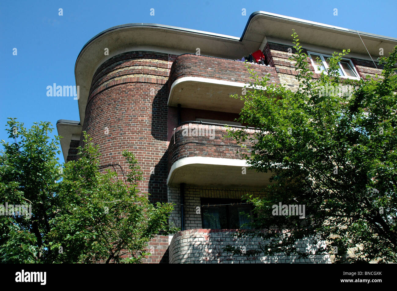Characteristic  curved Deco Brick Architecture on an inter war Public Housing  Project  Dublin Ireland Stock Photo