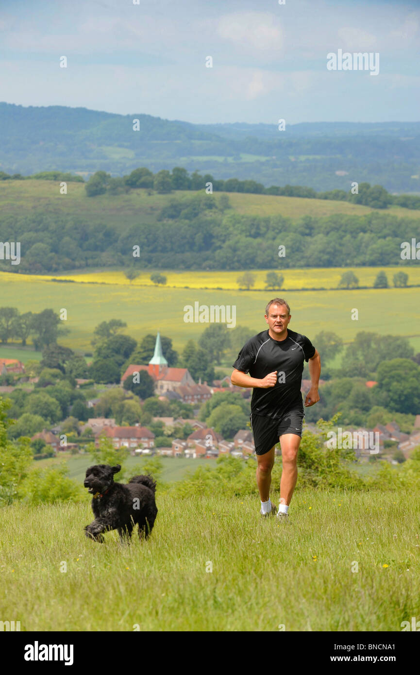 Actor Hugh Bonneville photographed running on the South Downs in West Sussex near Chichester. - Stock Image