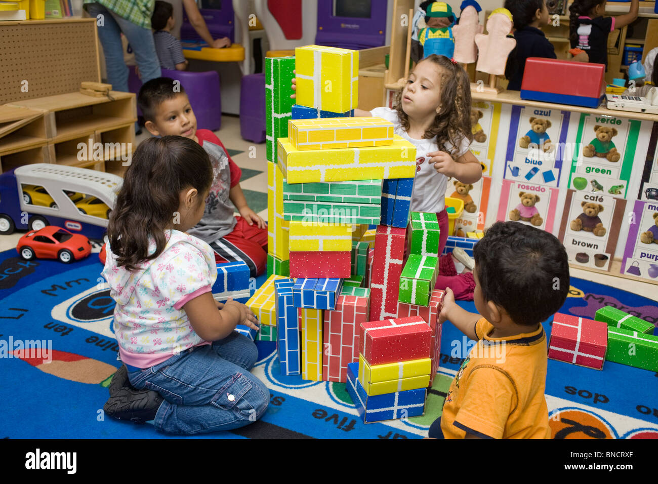 preschool children playing with blocks on the floor Stock ...