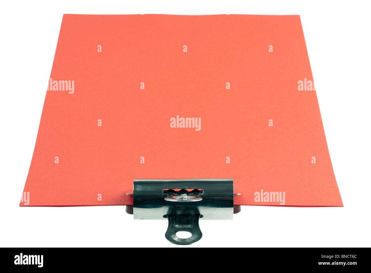 Sheets of red A4 paper and bulldog clip - Stock Image