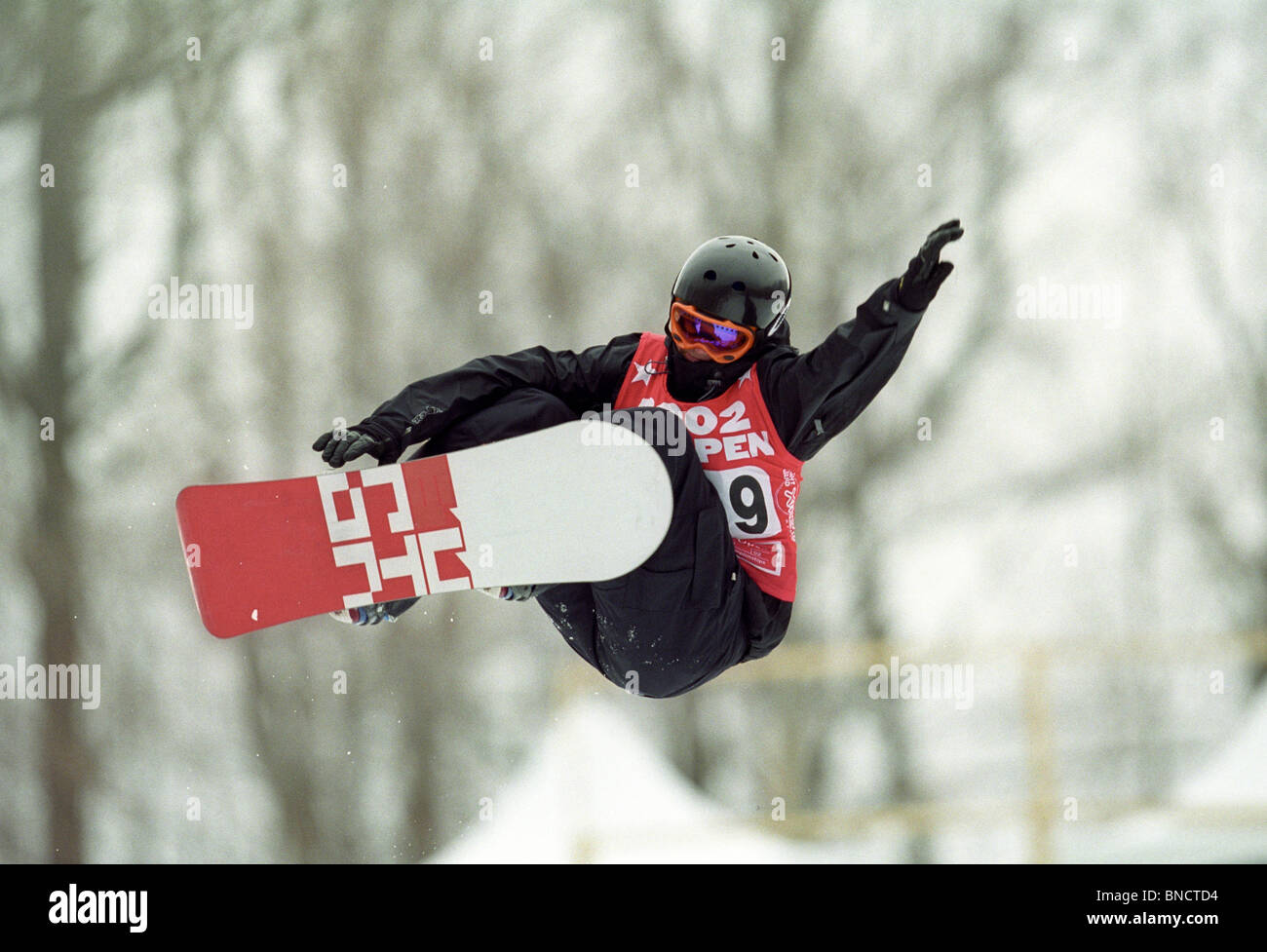 Kelly Clark (USA) competing in the snowboarding halfpipe at the 2002 US Open Snowboarding Championships. - Stock Image