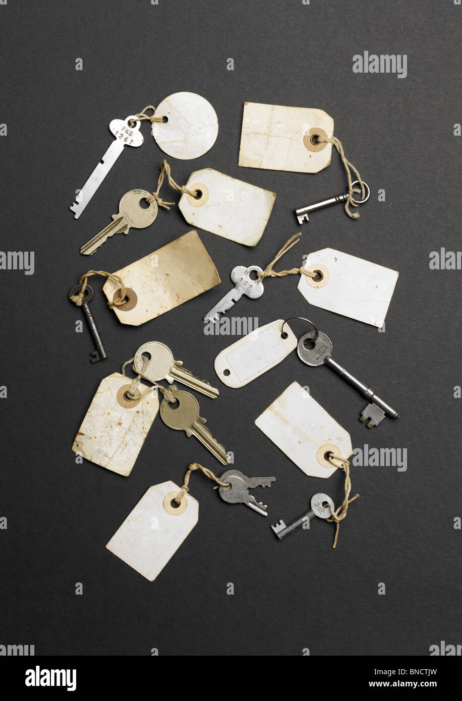 Old keys with labels without writing on them Stock Photo
