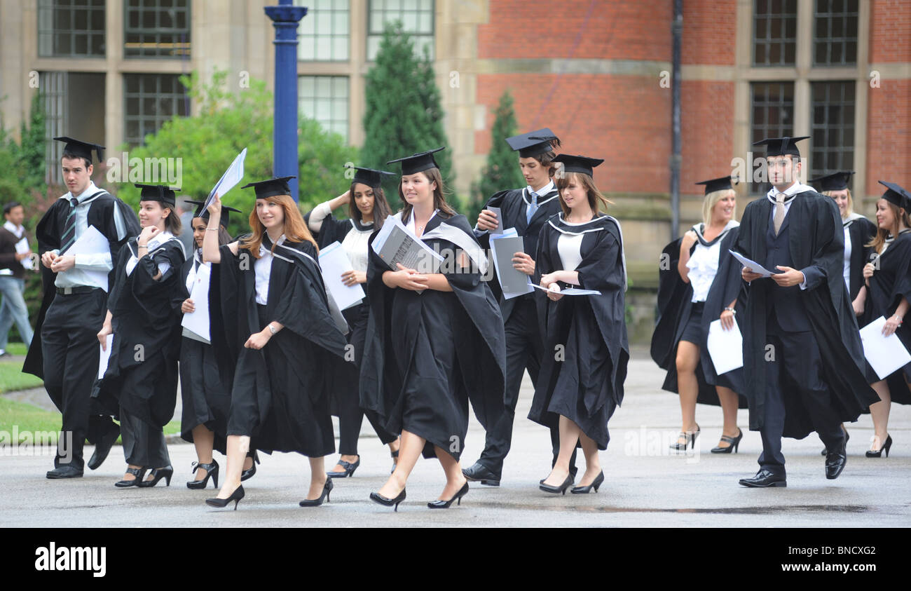 CELEBRATING GRADUATES FROM A BRITISH UNIVERSITY LEAVE THEIR GRADUATION CEREMONY WITH THEIR DEGREE CERTIFICATES,UK - Stock Image