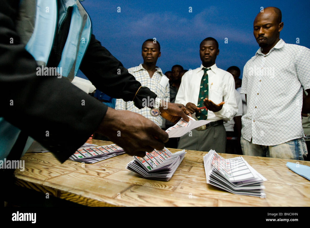 Electoral commission workers count ballots after the first round of presidential elections in Accra, Ghana - Stock Image