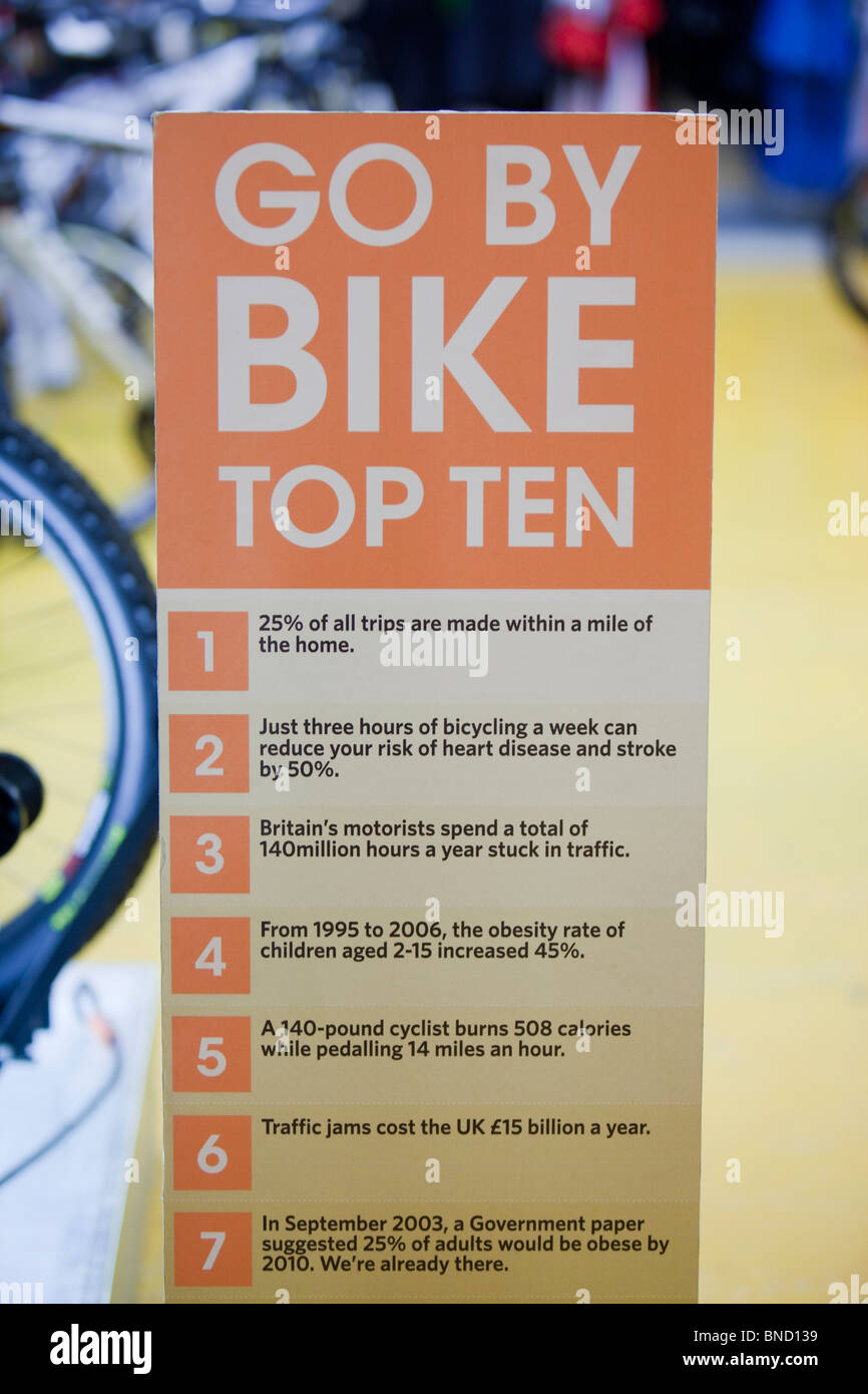 A poster about the benefits of cycling. - Stock Image