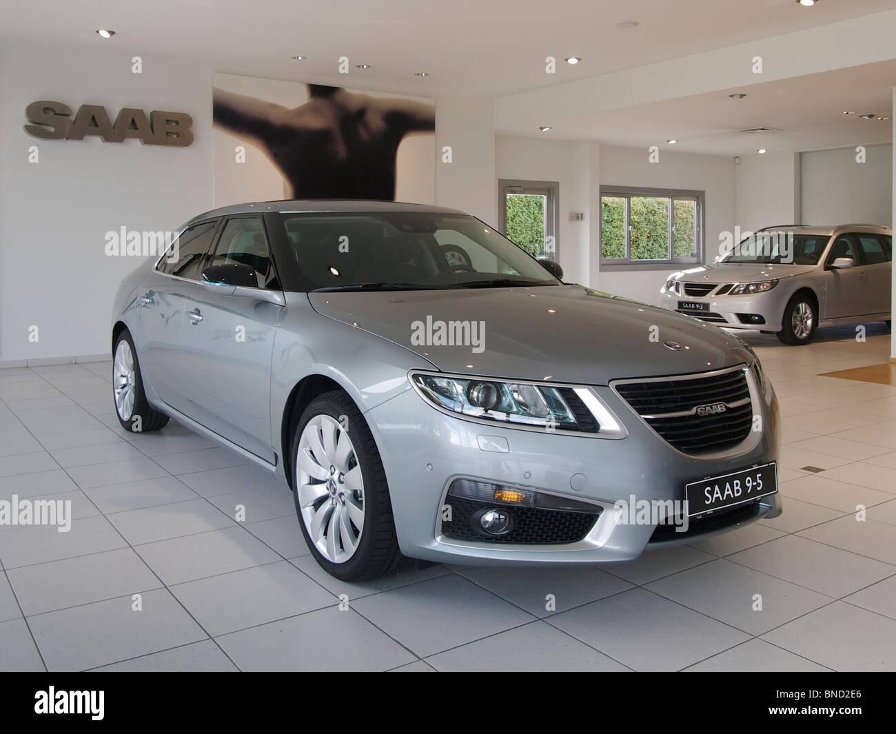 The new 2010 Saab 9-5 model in dealer showroom in Oud Turnhout, Belgium - Stock Image