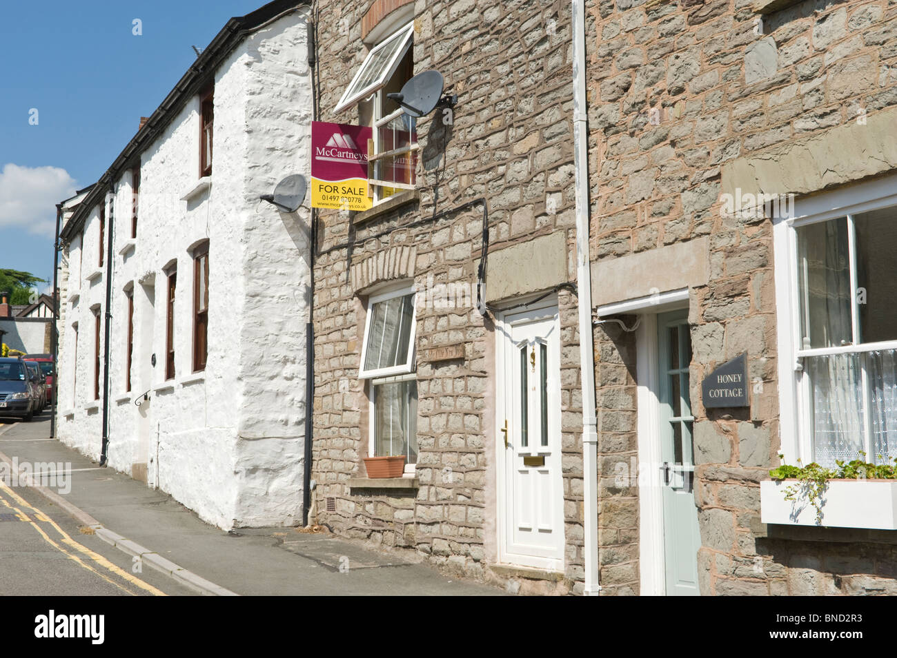 Stone built house for sale in terrace at Hay-on-Wye Powys Wales UK - Stock Image