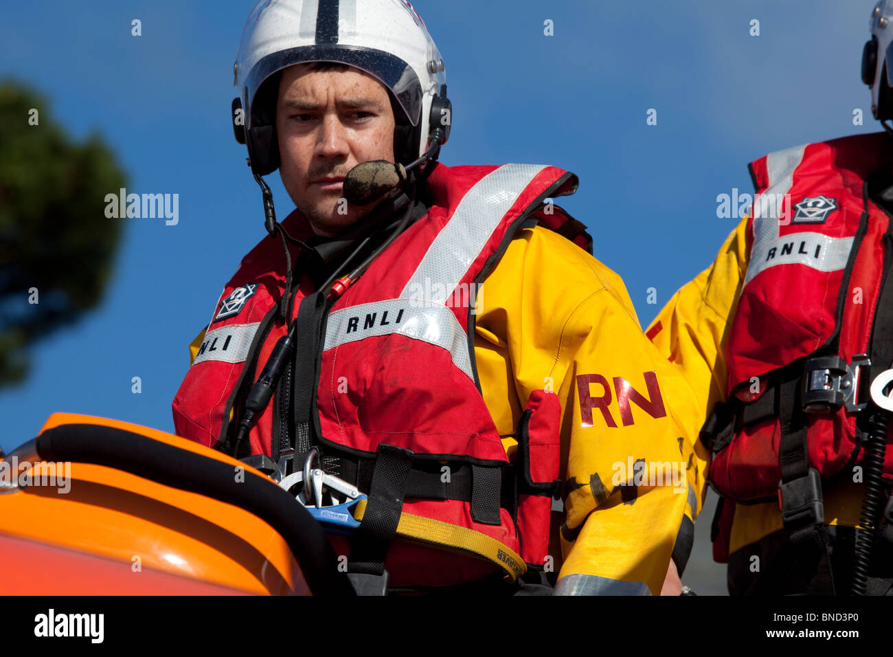 Rescue worker of the Royal National Lifeboat Institute (RNLI) on a training exercise. - Stock Image