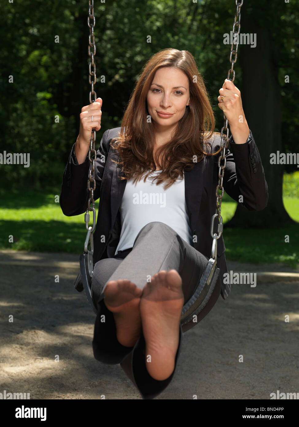 Young Attractive Businesswoman Sitting Barefooted On A