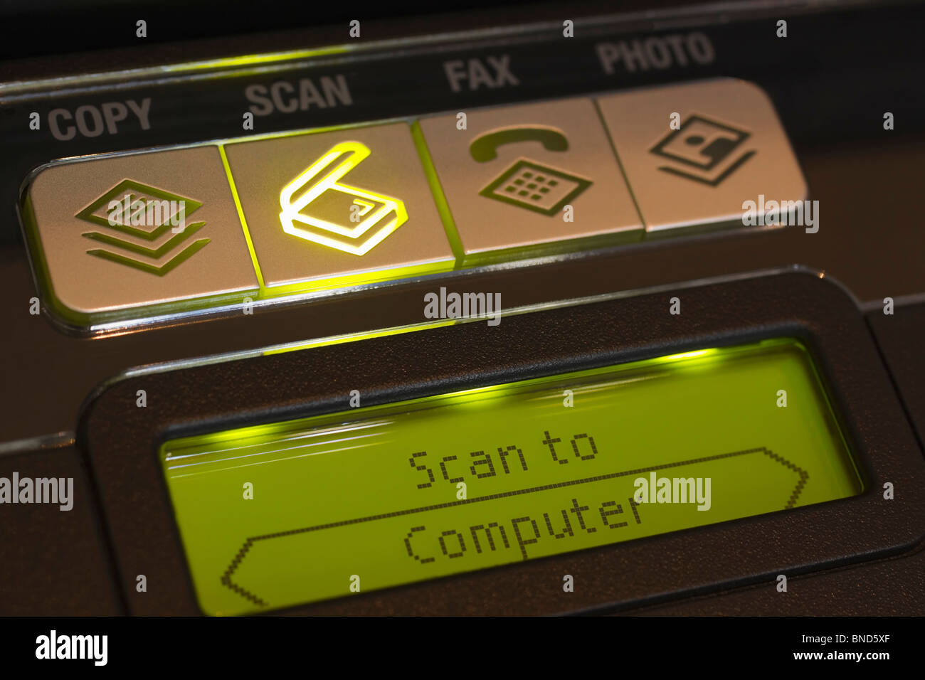 Control panel on a multifunction or All-In-One printer indicating selection of the scan option. - Stock Image
