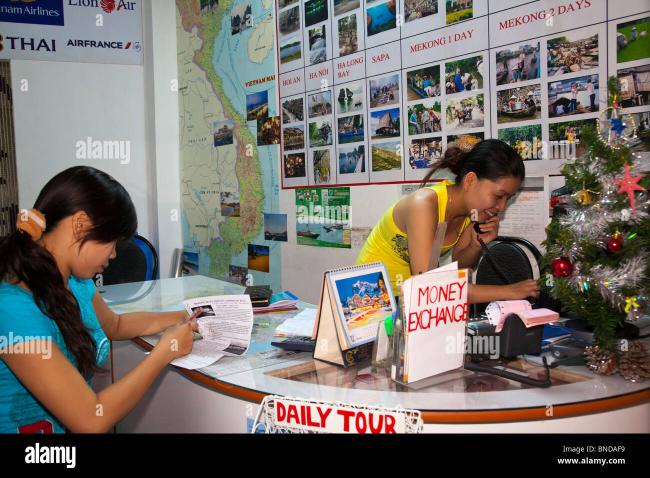 Vietnamese travel agent tour office travel information - Stock Image