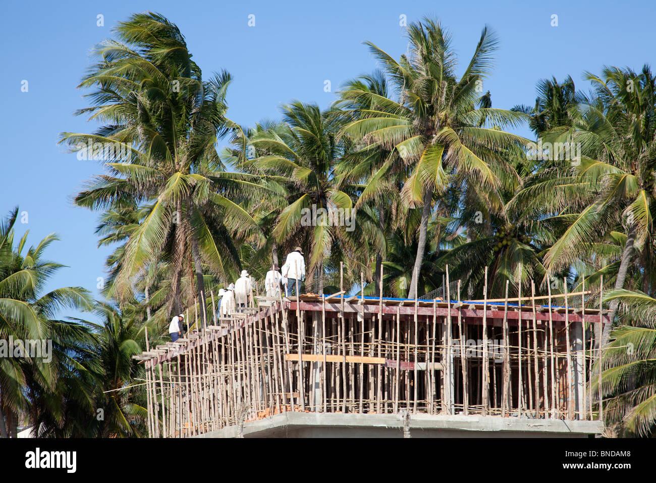 Building construction work Mui Ne Vietnam scaffolding - Stock Image