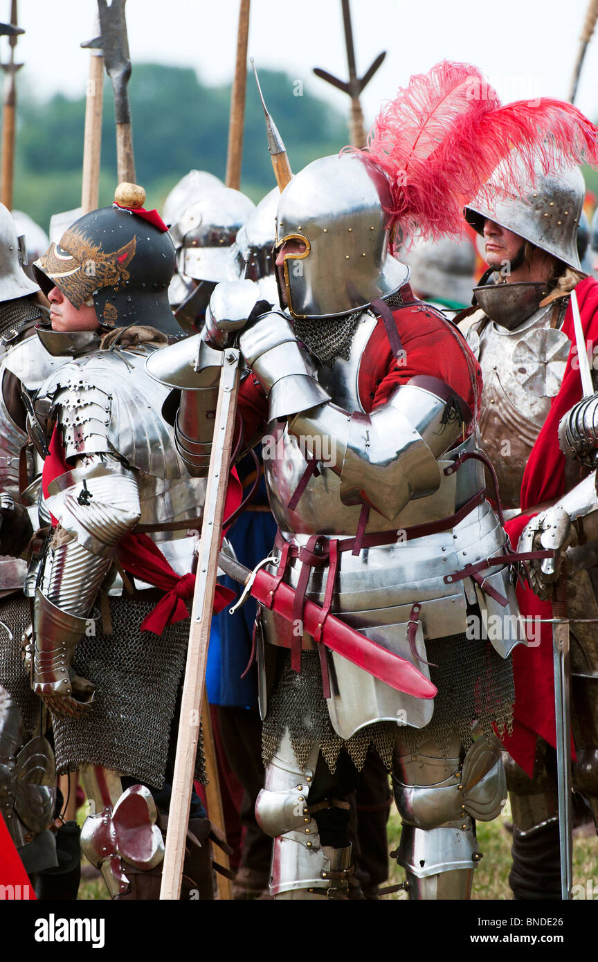 Knights in armor fighting on the battlefield at the re-enactment of the battle of Tewkesbury. Medieval festival - Stock Image
