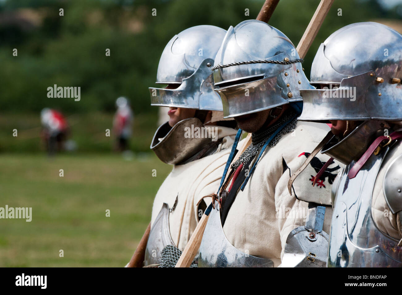 Knights in armor marching on the battlefield at the re-enactment of the battle of Tewkesbury. Medieval festival - Stock Image
