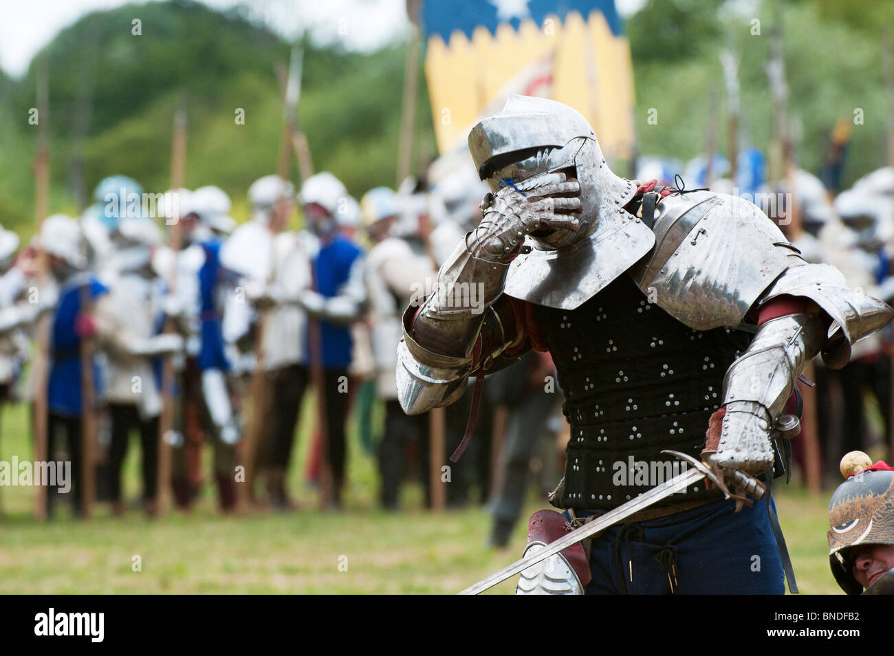 Wounded Knight in armor on the battlefield at the re-enactment of the battle of Tewkesbury. Medieval festival 2010. - Stock Image