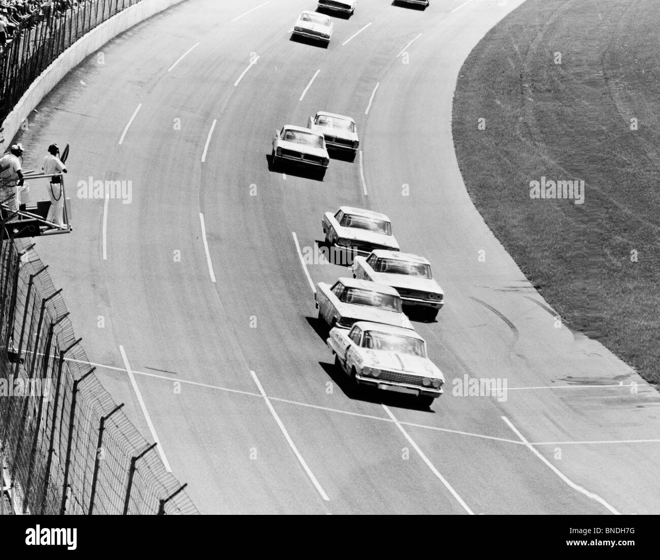 High angle view of stock cars on a racing track, Daytona Firecracker 400, Daytona Beach, Florida, USA - Stock Image