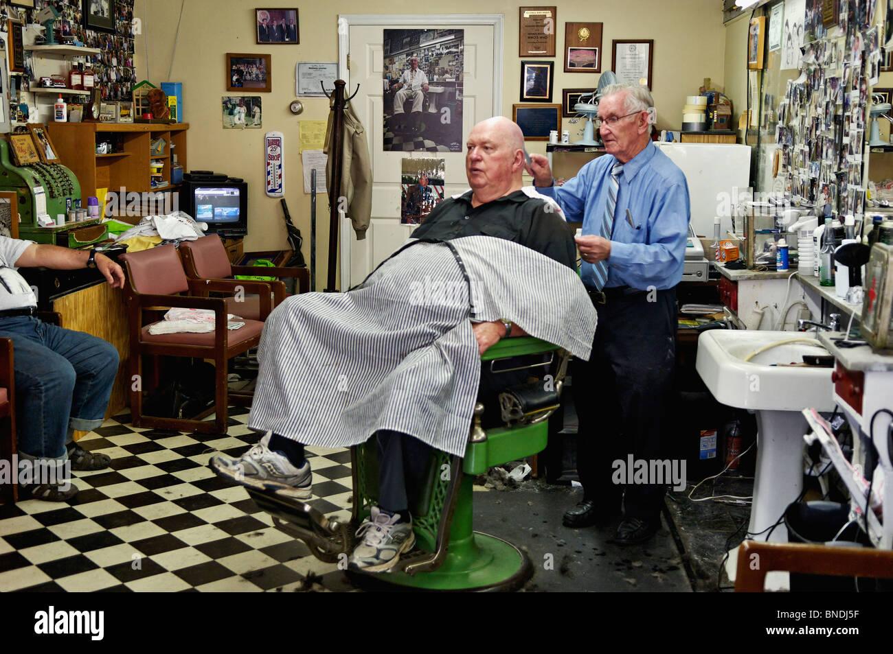 Russell Hiatt Cutting Hair in Floyd's City Barber Shop in Mount Airy, North Carolina Stock Photo