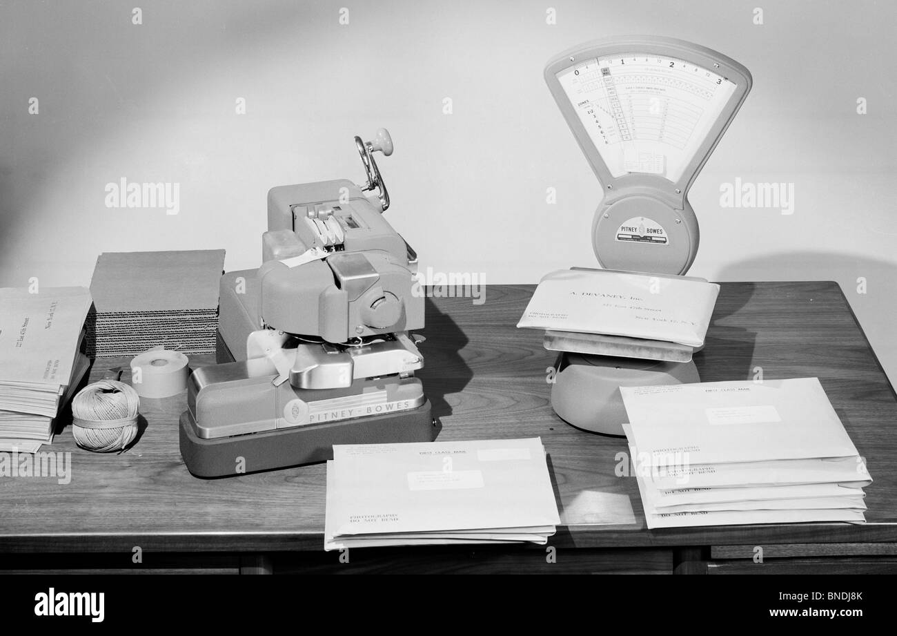 Close-up of a weight scale and postage meter machine on a table - Stock Image