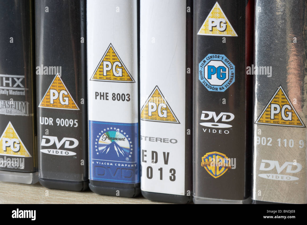 row of dvd video cases showing BBFC and irish film censors office PG classification notice from the uk Stock Photo