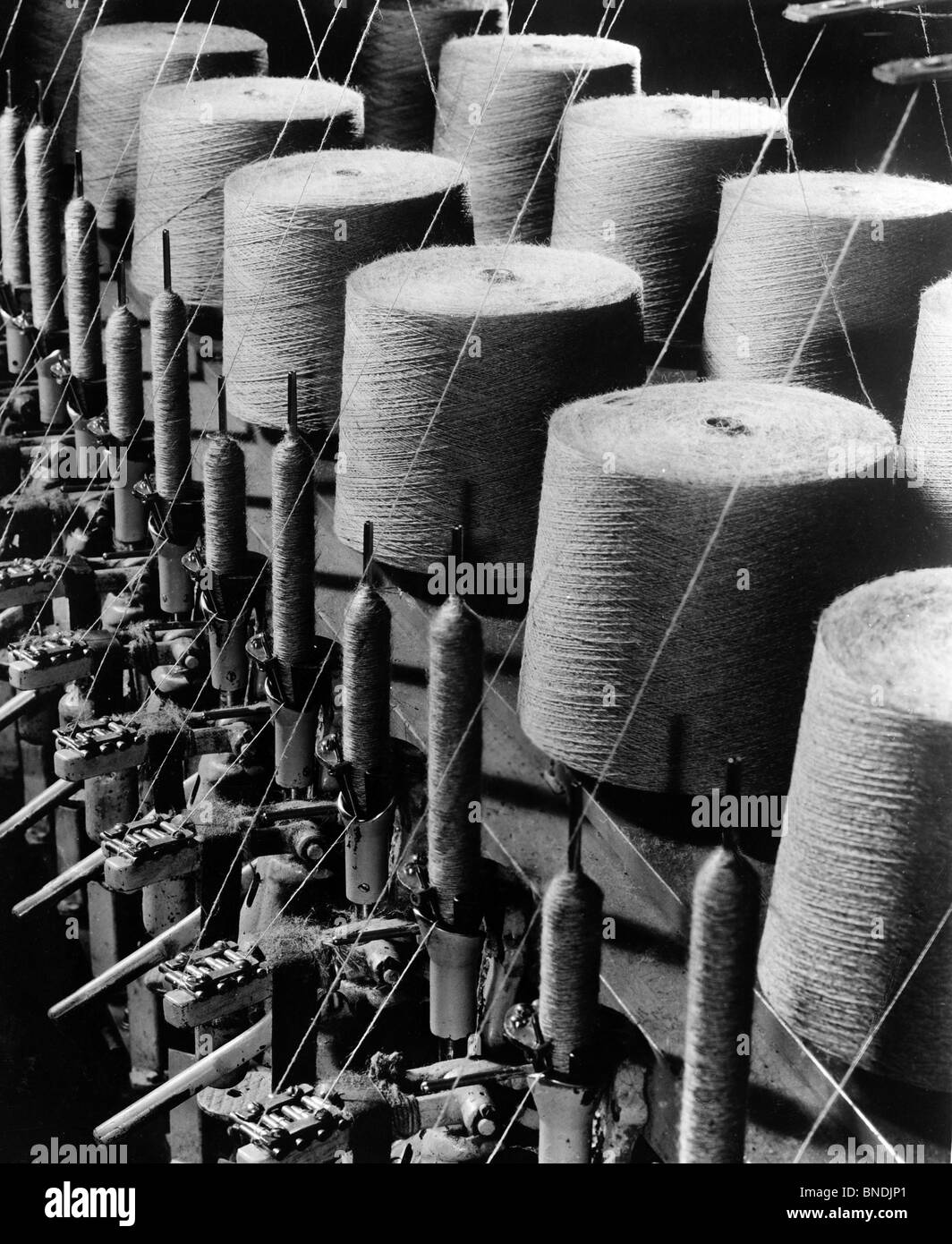 Spools of thread in textile factory - Stock Image